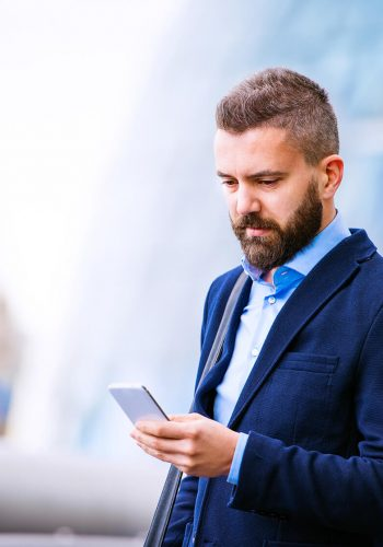 hipster-manager-with-smart-phone-london-city-hall-PBBAF8T